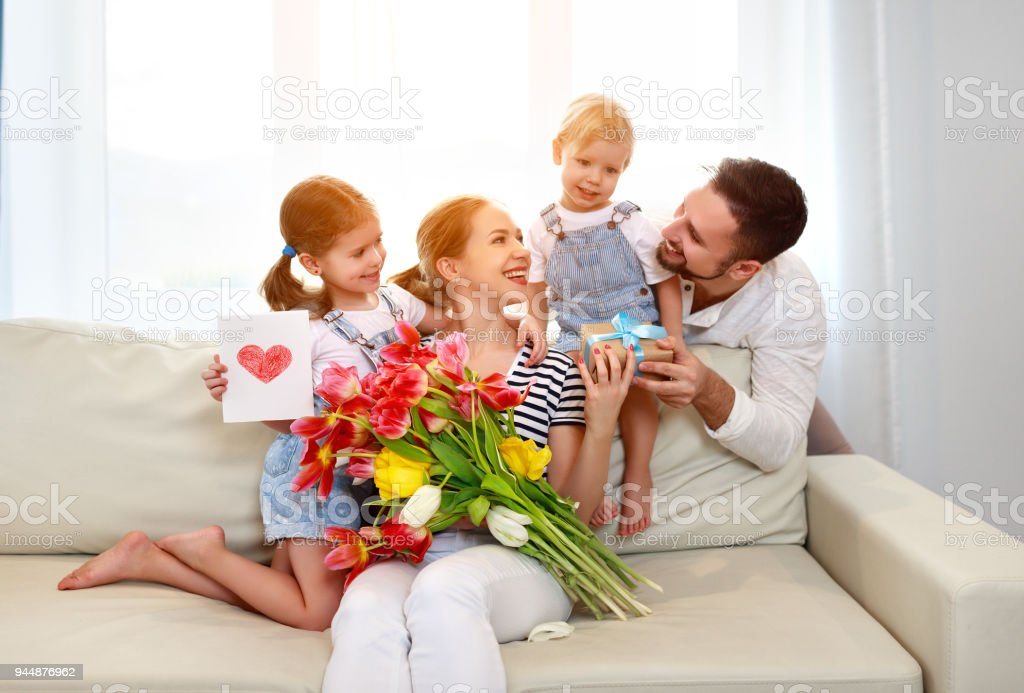 happy mother\'s day! father and children congratulate mother on...