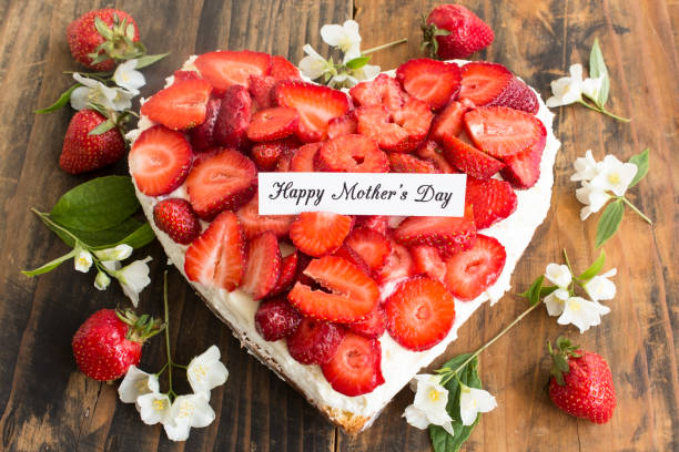 Happy Mother's Day,  Greeting Card,  with Heart Cheesecake with Strawberries stock photo