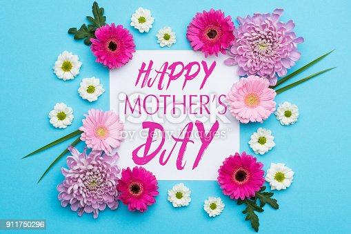 istock Happy Mother's Day Pastel Candy blue Colours Background. Floral flat lay minimalism greeting card. 911750296