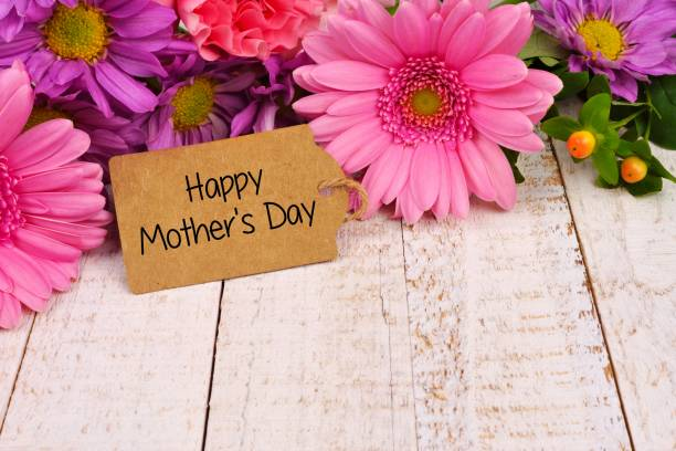 happy mothers day tag close up with flowers over white wood - mothers day stock pictures, royalty-free photos & images