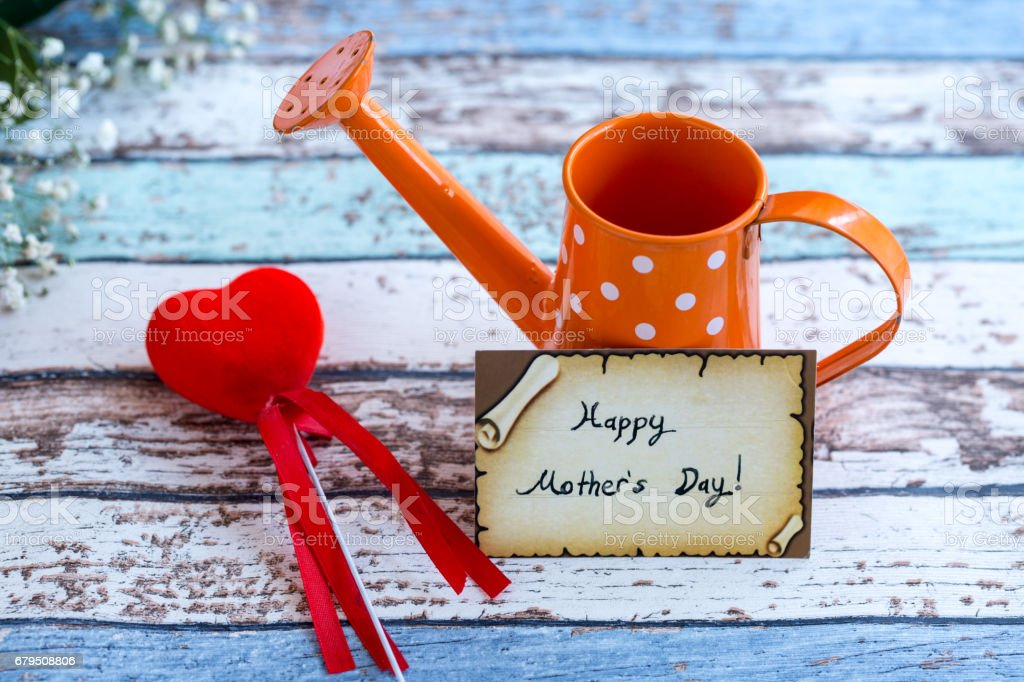Happy mother's day with heart and watering pot. royalty-free stock photo