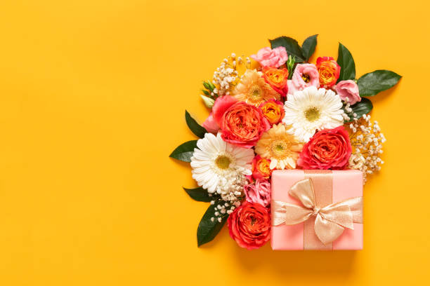 happy mother's day, women's day, valentine's day or birthday pastel candy colors background. floral flat lay greeting card with beautifuly wrapped present and copy space. - mothers day stock pictures, royalty-free photos & images