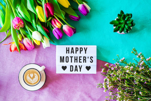 happy mother's day written in lightbox with spring flowers from above - mothers day stock pictures, royalty-free photos & images