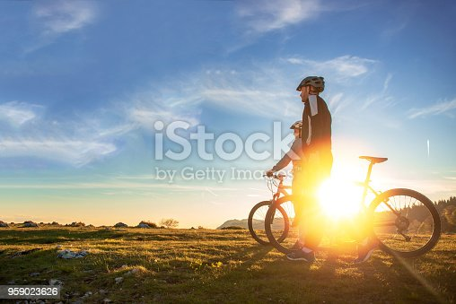 istock Happy mountain bike couple outdoors have fun together on a summer afternoon sunset 959023626