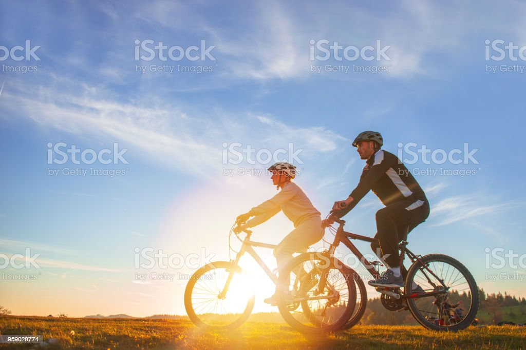 happy mountain bike couple outdoors have fun together on a summer