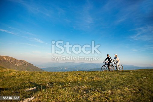 959028830 istock photo Happy mountainbike couple outdoors have fun together on a summer afternoon 838461648
