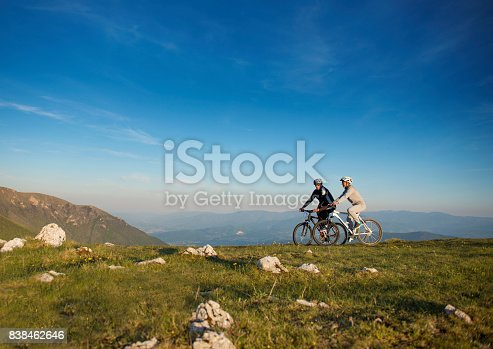 959028830 istock photo Happy mountainbike couple outdoors have fun together on a summer afternoon 838462646