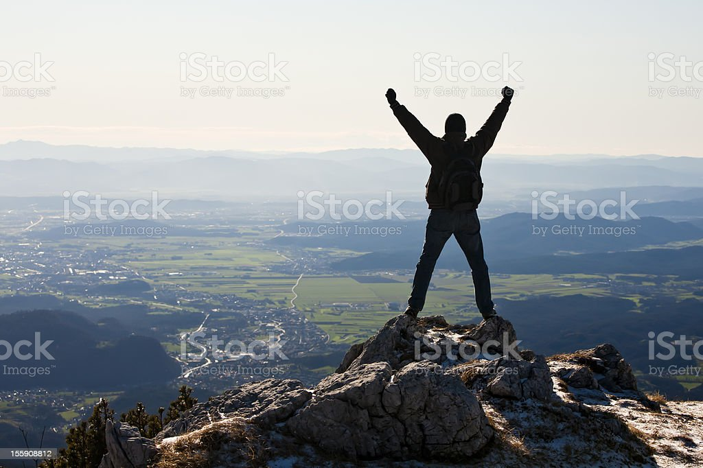 Happy mountaineer standing on the top royalty-free stock photo