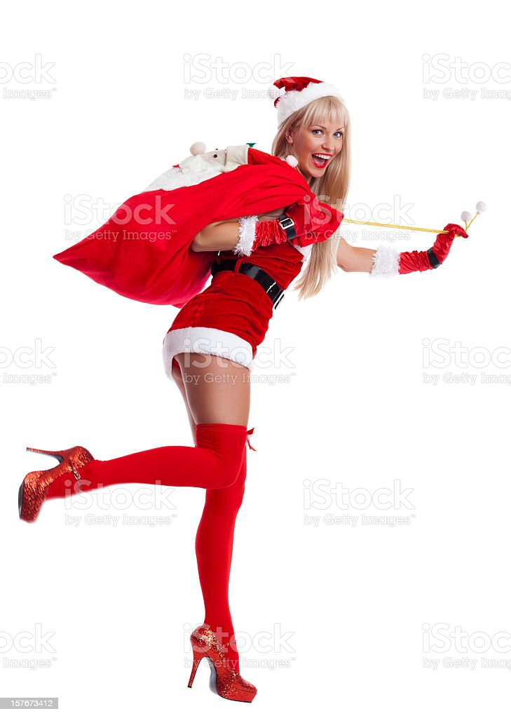 Happy Mrs. Santa Claus with bag on white stock photo