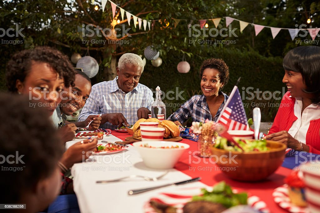 Happy multi generation black family at 4th July barbecue stock photo