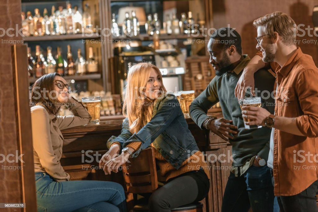 happy multiculture friends spending time in bar - Royalty-free Adult Stock Photo