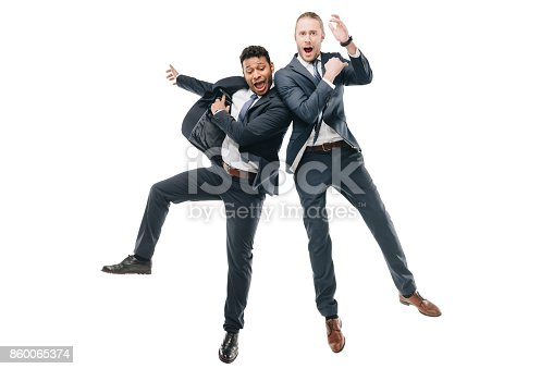 istock happy multiethnic businessmen 860065374
