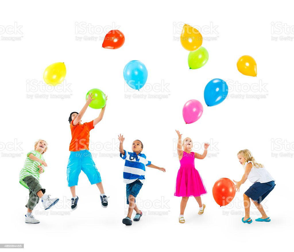 Happy Multi-Ethnic Children Playing Balloons Together stock photo