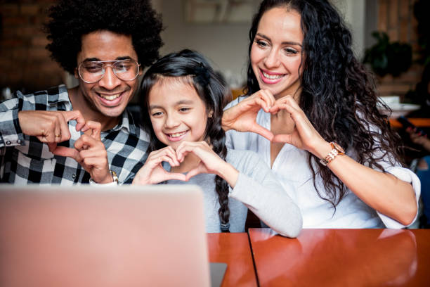 happy multiethnic family having fun while using laptop together, video chat concept - family gatherings stock pictures, royalty-free photos & images