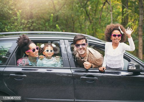 972962180 istock photo Happy multiethnic family traveling by car on vacation 1226067222