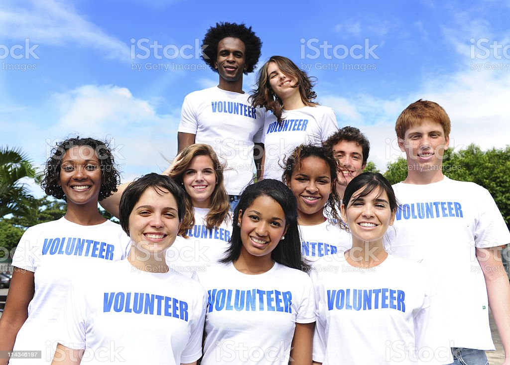 happy multi-ethnic volunteer group stock photo