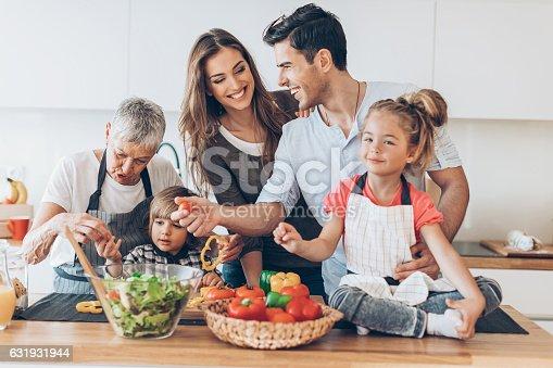 638984280 istock photo Happy multi-generation family in the kitchen 631931944