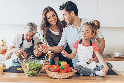 638984280 istock photo Happy multi-generation family in the kitchen 631931944