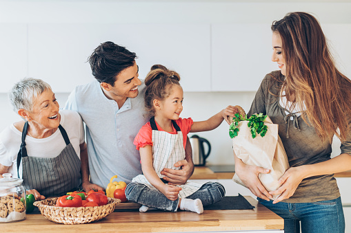 638984280 istock photo Happy multi-generation family with groceries 635846148