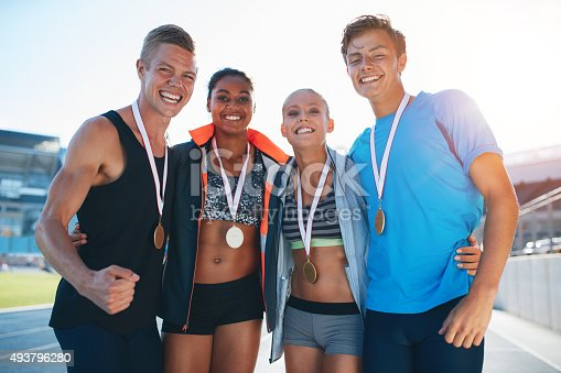 istock Happy multiracial athletes celebrating victory 493796280