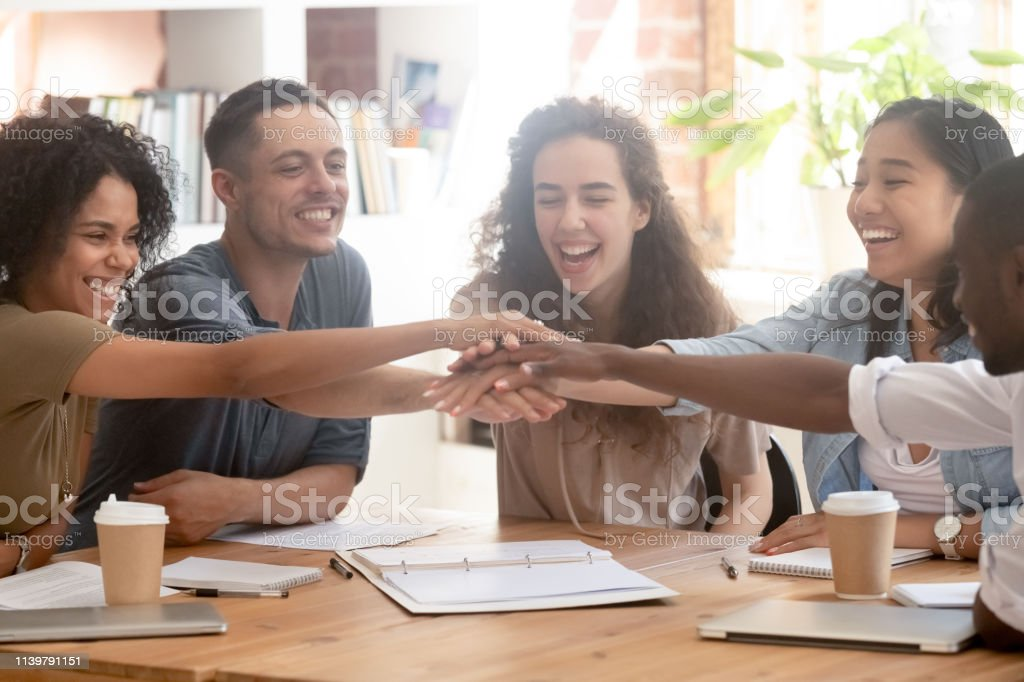 Happy multiracial business people colleagues stacking hands motivated by success - Royalty-free Adult Stock Photo