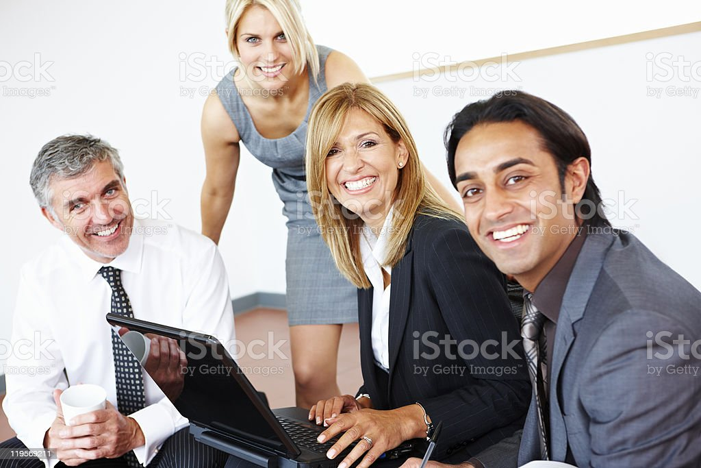 happy multiracial business team working on laptop royalty-free stock photo