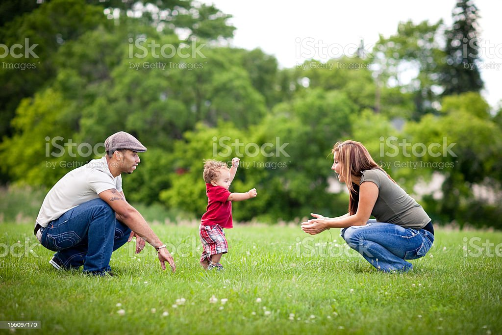 Happy, Multiracial Family Playing Together Outside During Summer stock photo