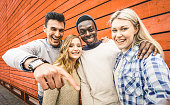 istock Happy multiracial friends group taking selfie with mobile smart phone - Young hipster people addicted by smartphone on social network community - Lifestyle technology concept on vivid contrast filter 861023492