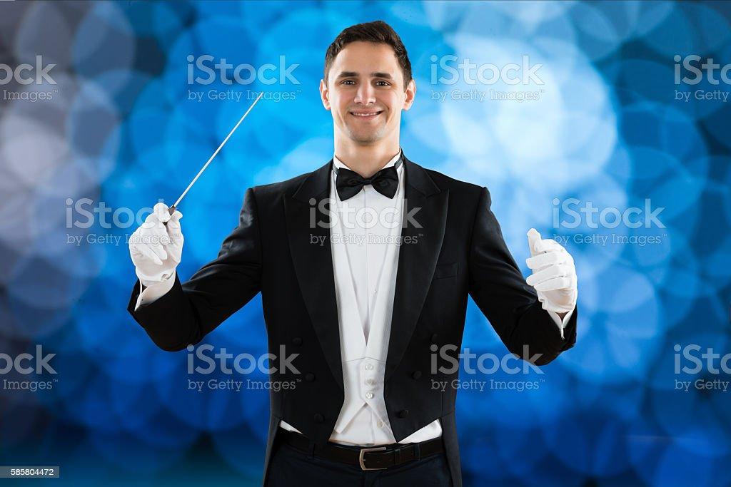 Happy Music Conductor Holding Baton stock photo