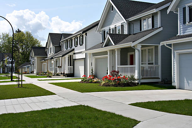 Happy neighbourhood Small town residential street of new town homes.  residential district stock pictures, royalty-free photos & images