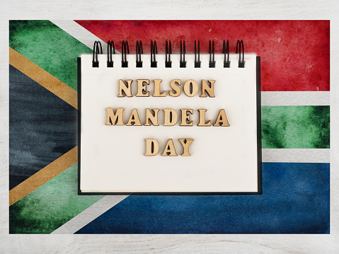 Happy Nelson Mandela Day. Beautiful greeting card. Closeup, view from above. National holiday concept. Congratulations for family, relatives, friends and colleagues