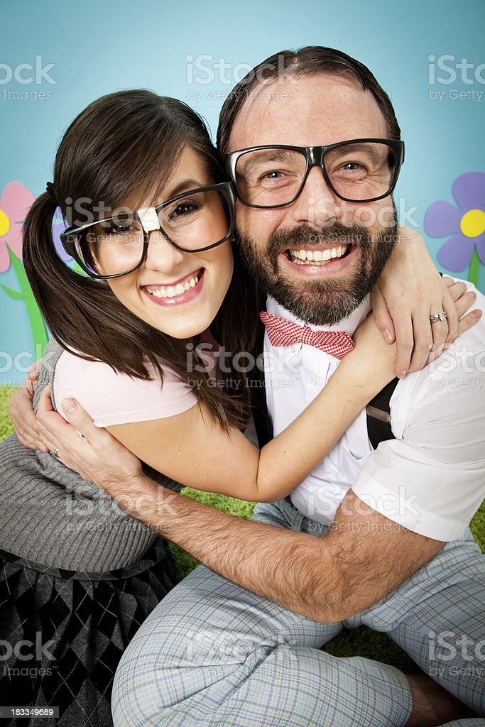 Happy Nerd Couple Hugging Each Other Outside stock photo