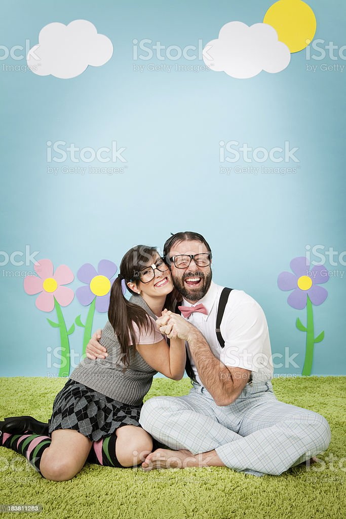 Happy Nerd Couple Hugging in Whimsical, Outdoor World stock photo