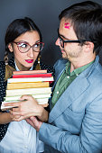 istock Happy nerd couple looking at each other 578837534