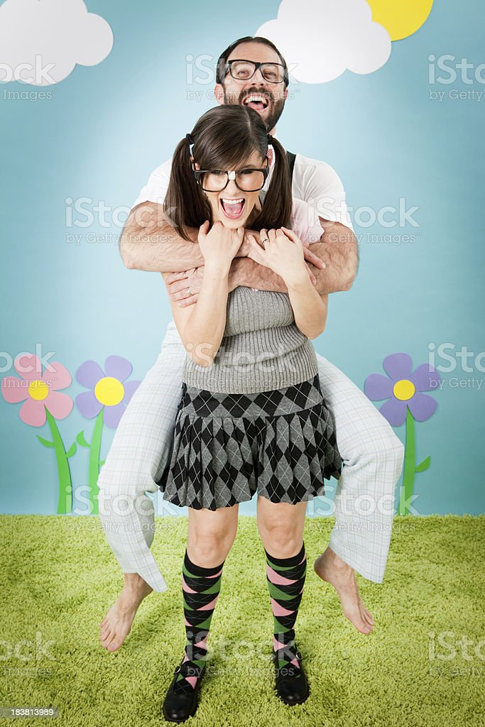 Happy Nerd Couple Playing and Laughing in Whimsical World royalty-free stock photo