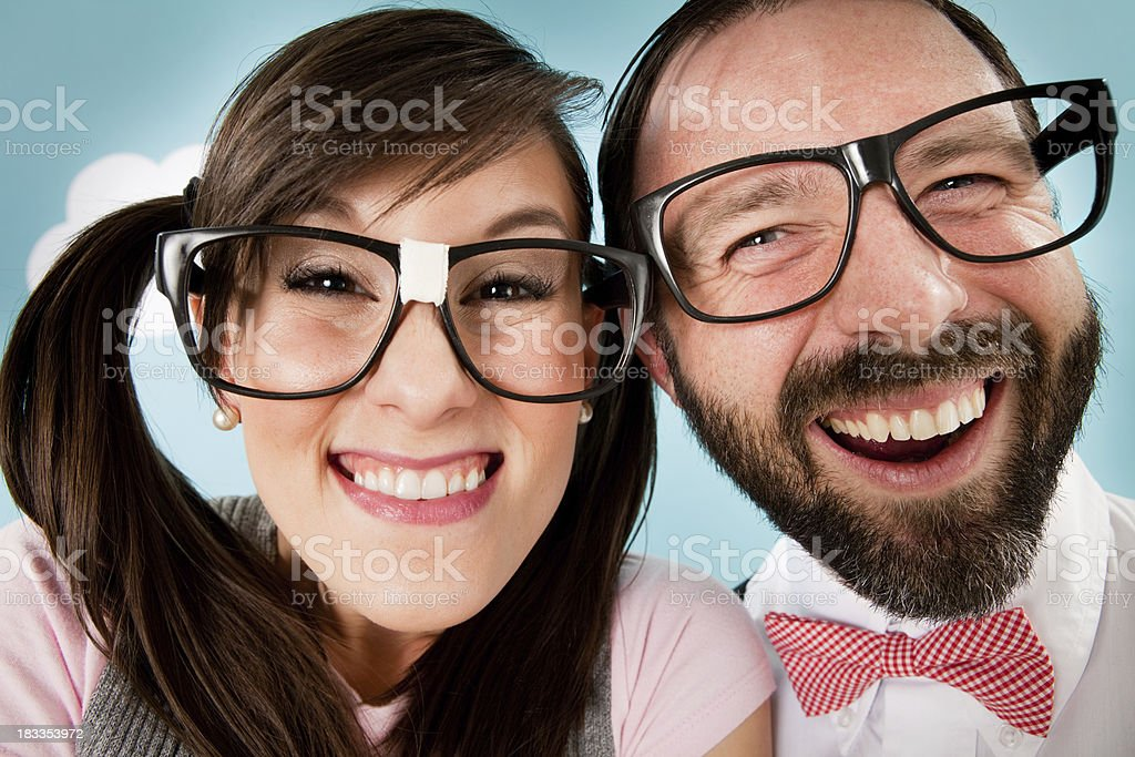 Happy, Nerd Couple Smiling and Laughing Together stock photo