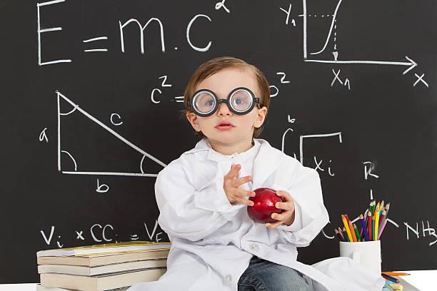 Happy nerd gifted boy stock photo