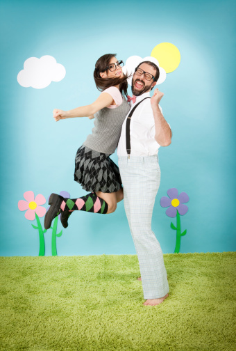 istock Happy Nerd Girl Jumping and Bumping Into Nerdy Guy 184983218