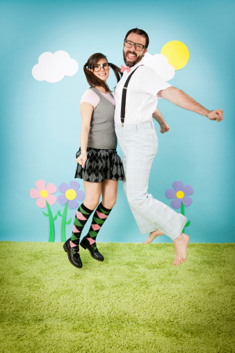 istock Happy Nerd Girl Jumping and Bumping Into Nerdy Guy 185311282