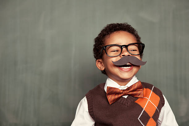 Happy Nerd A young nerd celebrates Movember, men's health month. mustache stock pictures, royalty-free photos & images