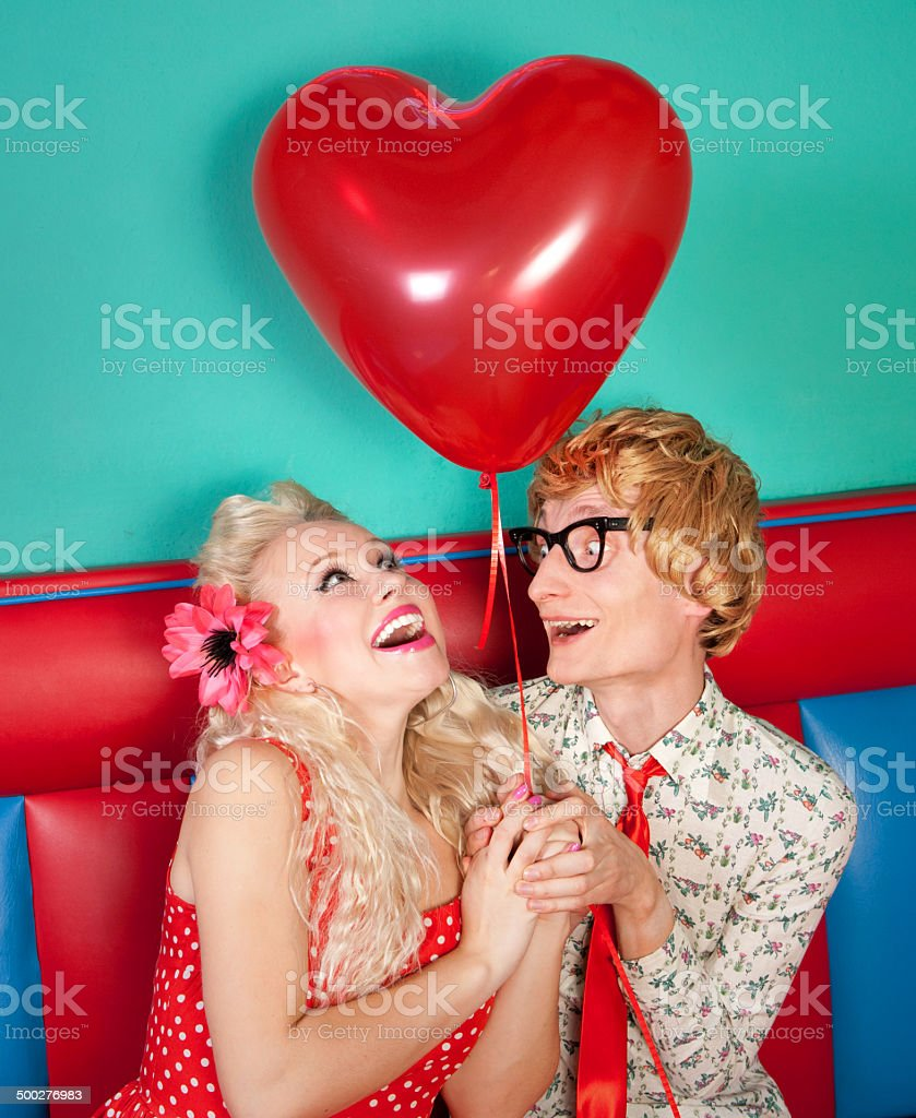 Happy nerdy couple stock photo