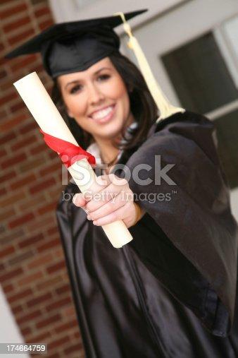 istock Happy New Female Graduate Holding Diploma 174664759