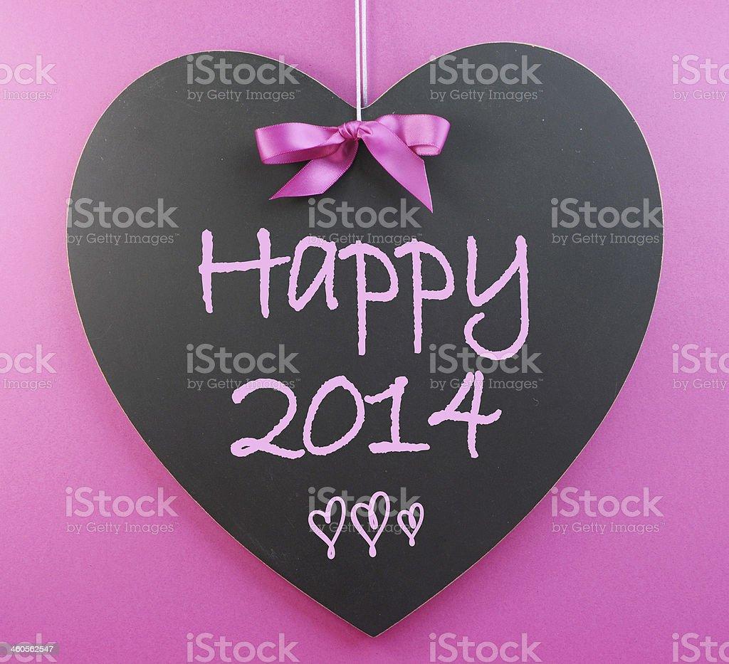 Happy new year 2014 greeting written on heart shape blackboard stock happy new year 2014 greeting written on heart shape blackboard royalty free stock photo m4hsunfo