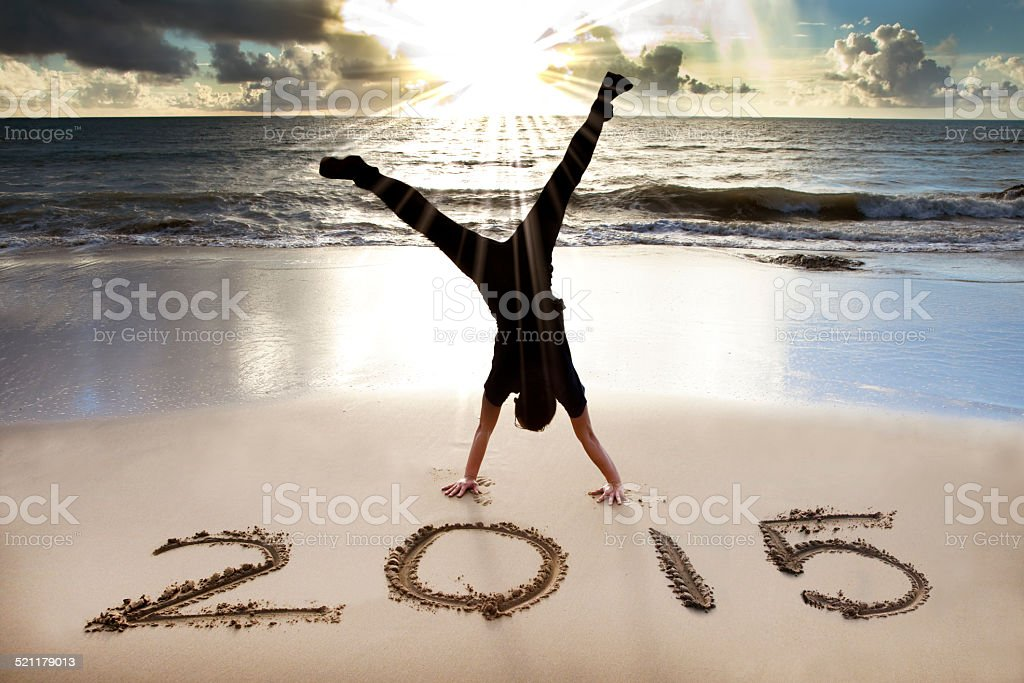 happy new year 2015 on the beach with sunrise stock photo