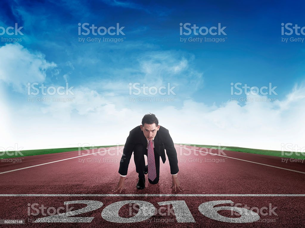 Happy new year 2016. young man running stock photo