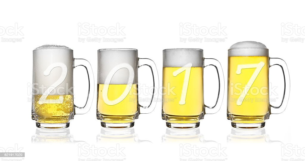 happy new year 2017 and merry christmas on light beer royalty free stock photo