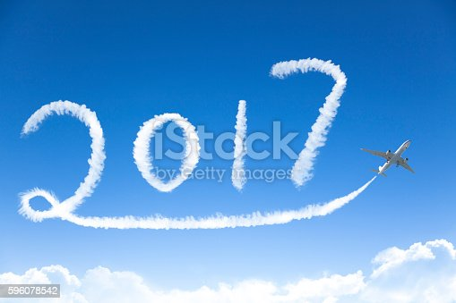 istock happy New year 2017 drawing by airplane in the sky 596078542