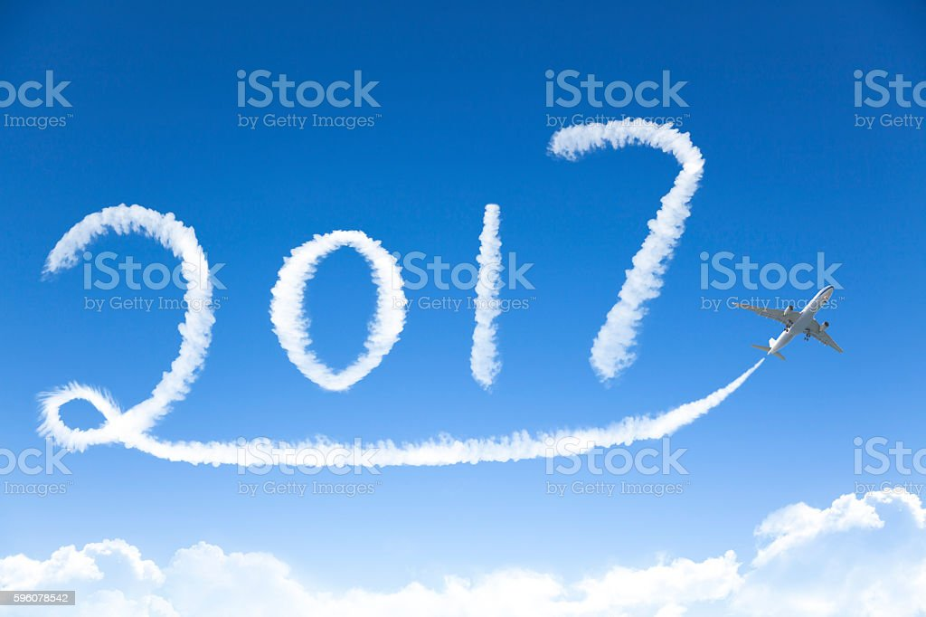 happy New year 2017 drawing by airplane in the sky stock photo