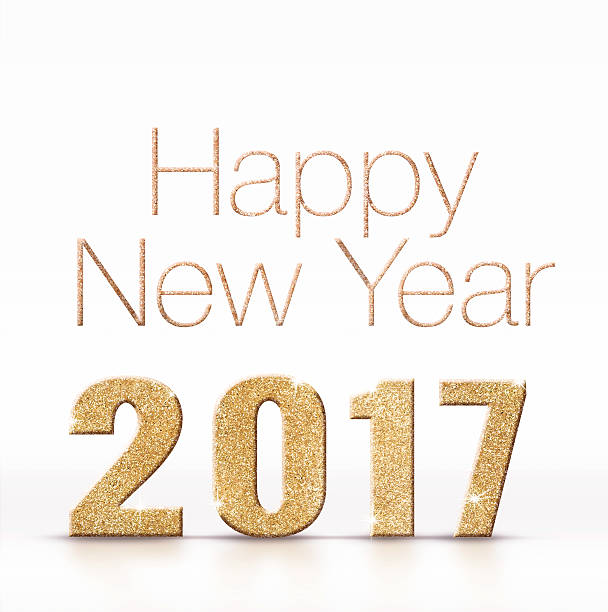Happy new year 2017 golden sparkling glitter on white studio stock photo