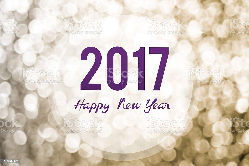 Happy new year 2017 on golden bokeh light background stock photo